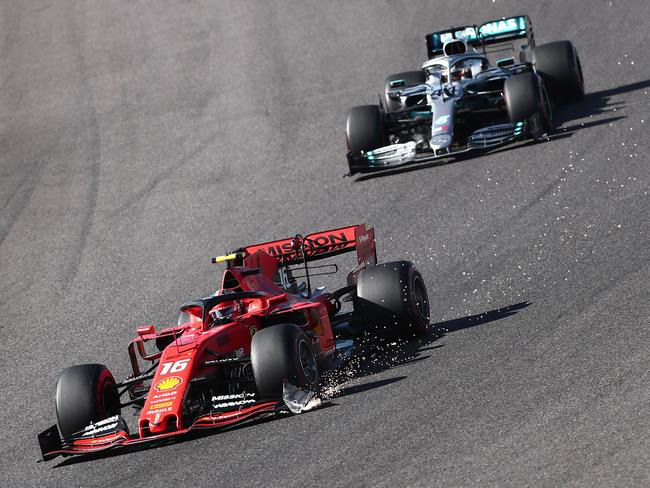 Charles Leclerc leads Lewis Hamilton. (Photo by Behrouz MEHRI / AFP)