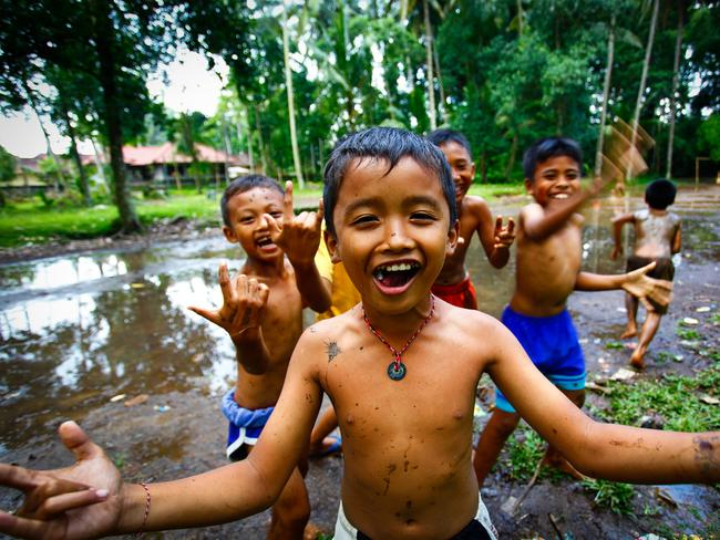 Meeting the locals is a highlight of travelling in Indonesia. Picture: Intrepid Travel