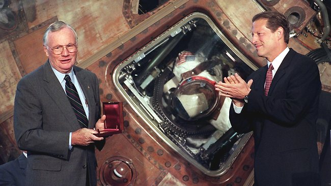 US Astronaut Neil Armstrong is awarded the Samuel P. Langely medal in front of the Apollo 11 Columbia Command Module during a ceremony on the 30th anniversary of the moon landing as US Vice President Al Gore applauds in 1999 at the National Air and Space Museum in Washington DC. AFP PHOTO