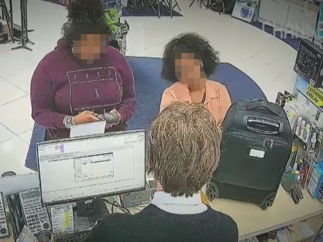 One of the women distracts the cashier while the other allegedly types in the stolen card details. Picture: A Current Affair