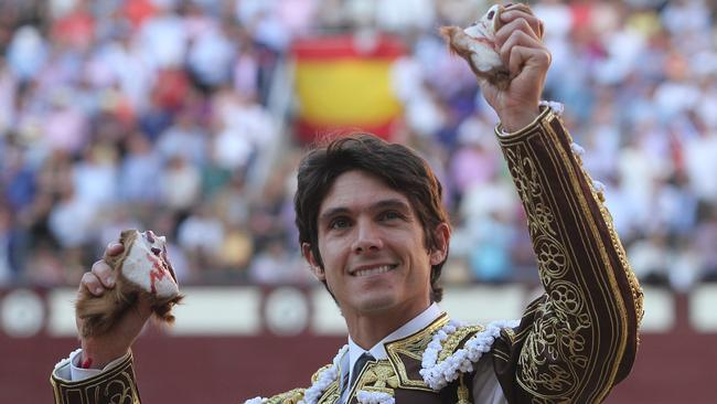 French matador (bullfighter) Sebastian Castella smiles as he shows his bull's ears last week in Madrid. Picture: Alberto Simon