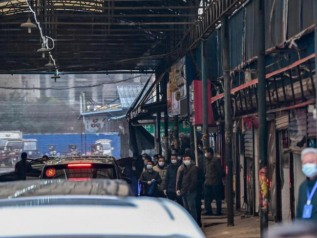 The World Health Organisation (WHO) team arrives at the closed Huanan Seafood wholesale market in Wuhan, China's central Hubei province on January 31. Picture: Hector Retamal / AFP