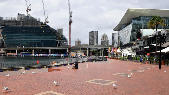 The new normal: Sydney's usually busy Darling Harbour is empty. Picture: Dan Himbrechts/AAP