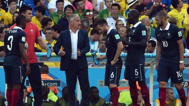 France's coach Didier Deschamps speaks with his footballers during a quarter-final break.