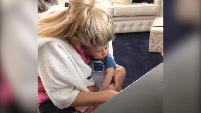 Tiffiny Hall plays piano for baby Arnie