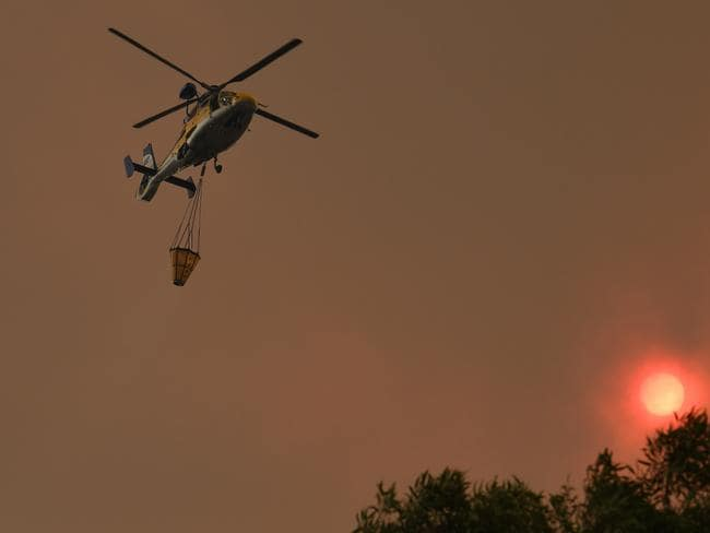 Water bombing aircraft battle the Green Wattle Creek Fire. Picture: AAP Image/Dean Lewins