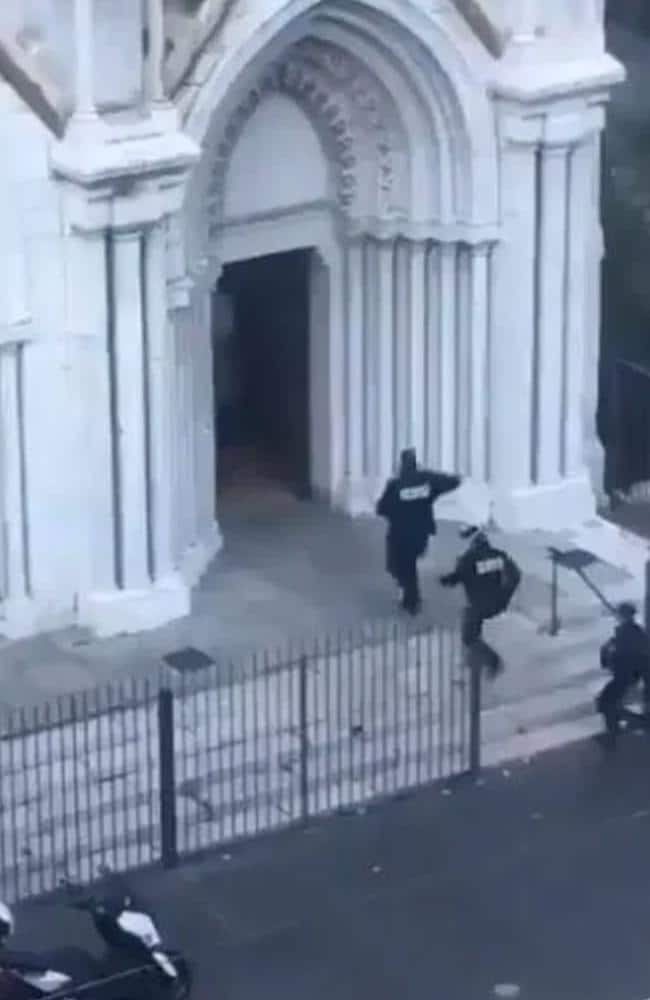 Police enter the Notre Dame church in Nice.