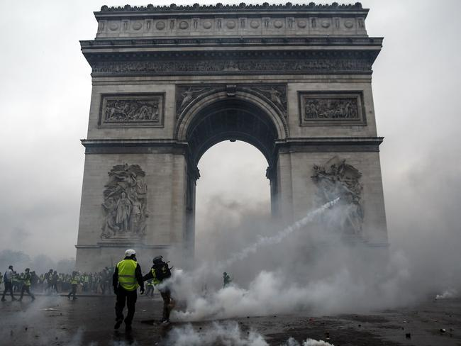 Demonstrators clash with riot police at the Arc de Triomphe during a protest of Yellow vests. Picture: Abdulmonam Eassa/AFP