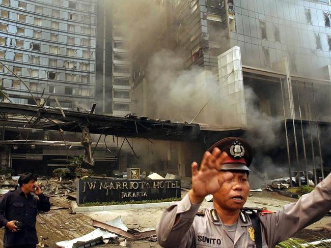 Aimed at Australia ... a policeman tries to keep order at the front entrance to the JW Marriott Hotel in Jakarta after a powerful car bomb exploded killing at least ten and injuring around 150 people. Picture: Supplied