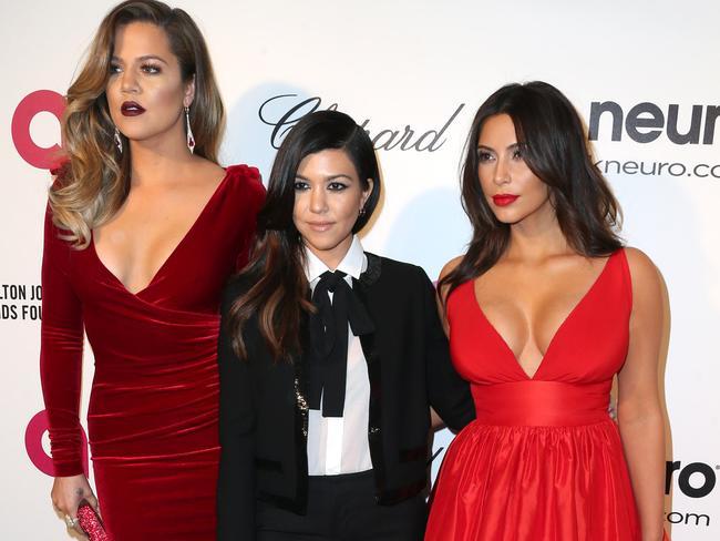 Reality experts: Khloe Kardashian, Kourtney Kardashian and Kim Kardashian. Photo by Frederick M. Brown/Getty Images