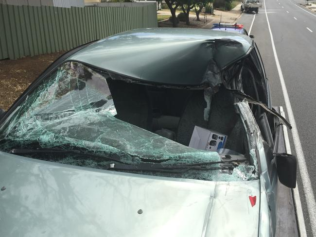 A 7-year-old boy has suffered serious facial injuries after the car he was travelling in hit a parked ute in Sheidow Park. Picture: SAPOL