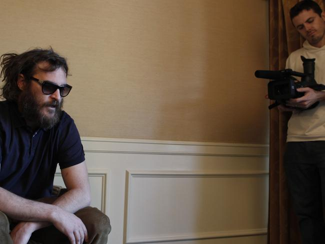 Casey Affleck films Joaquin Phoenix for  <i>I'm Not Here</i>. Picture: AP/Matt Sayles