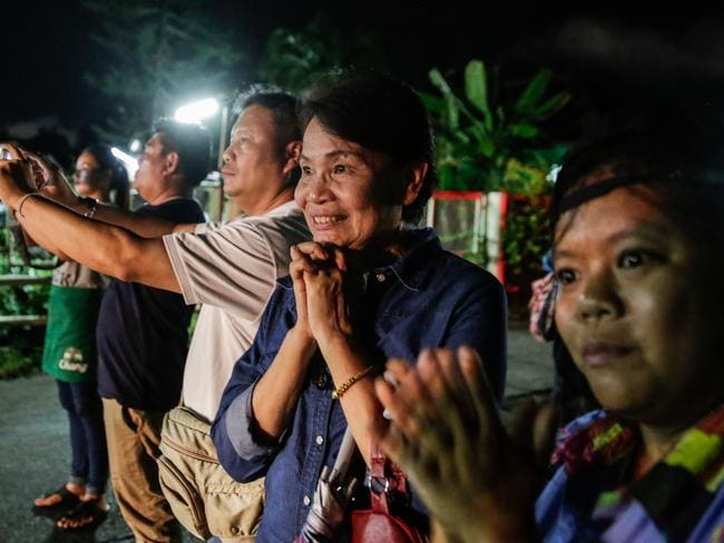 Onlookers watch and cheer as ambulances deliver the boys rescued from the cave to hospital in Chiang Rai. Picture: Lauren DeCicca/Getty Images
