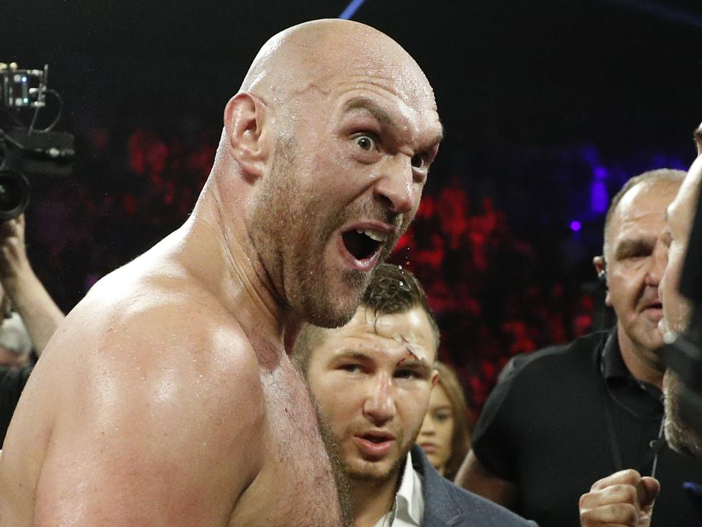 Tyson Fury, of England, celebrates after defeating Tom Schwarz, of Germany, in a heavyweight boxing match Saturday, June 15, 2019, in Las Vegas. (AP Photo/John Locher)