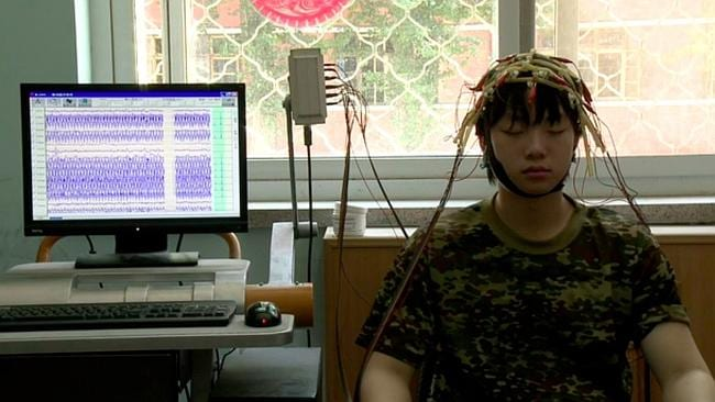 Plugged in to measure brain activity.