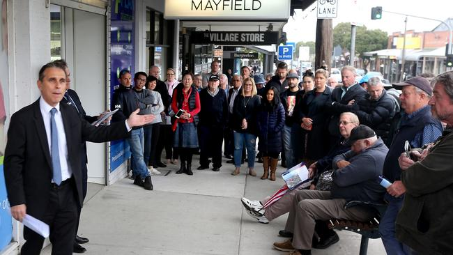 A big crowd witnessed the auction on the busy retail strip. Picture: Glenn Ferguson
