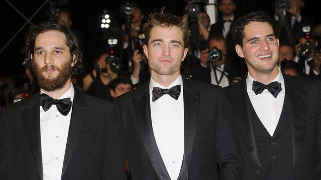 Robert Pattinson with Good Time director Benny Safdie (left), and director Josh Safdie. Picture: AP Photo/James McCauley