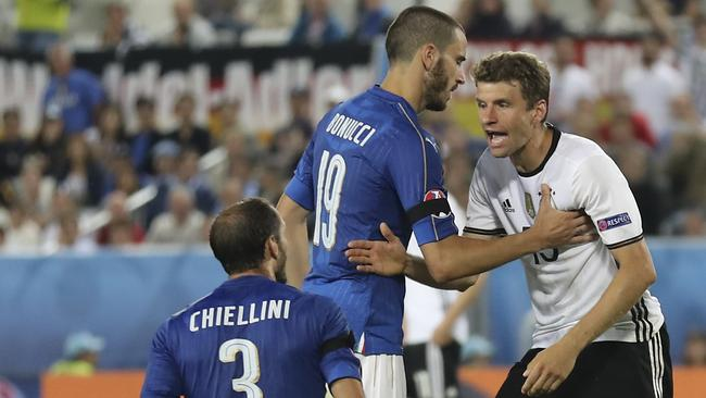 Germany's Thomas Mueller, right, faces Italy's Giorgio Chiellini.