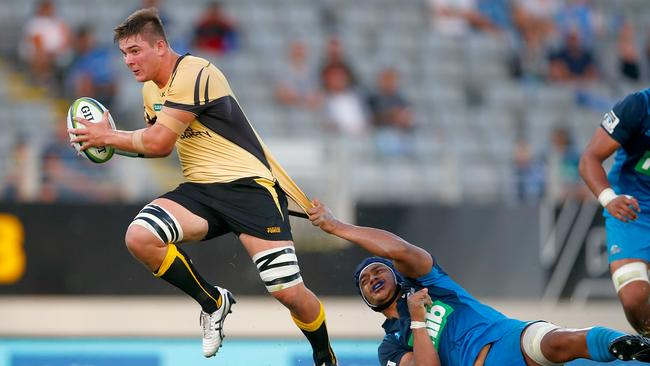 Richard Hardwick of the Force is tackled at Eden Park.