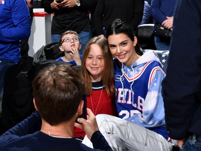 Kendall Jenner posed for a photo with a young fan at the Wells Fargo Center in Philadelphia. Picture: AFP