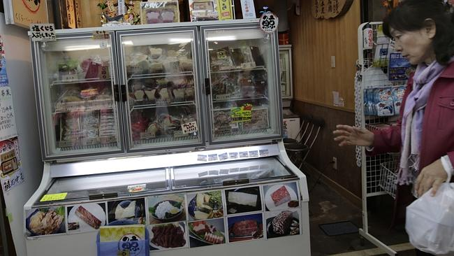 For sale ... a shopper walks past a whale meat specialty store in Tokyo's Ameyoko shopping district.