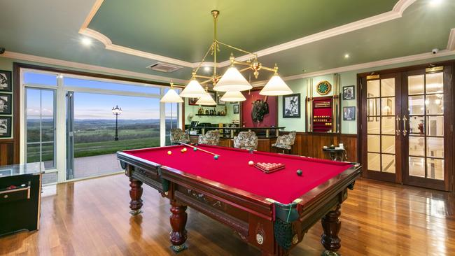 A billiard room with wet bar is included.