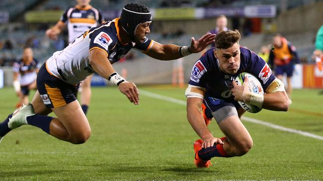 Tom English of the Rebels scores a try at GIO Stadium in Canberra.