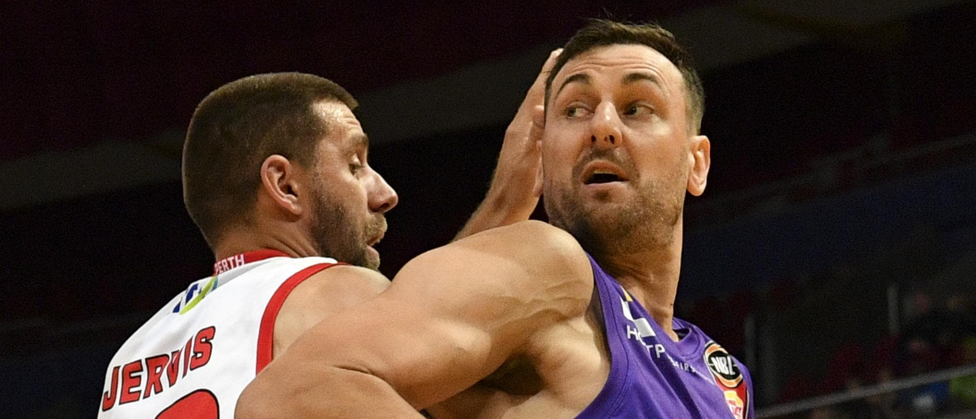 Andrew Bogut (right) of the kings competes for possession against Tom Jervis of the Wildcats during the Round 8 NBL match between Sydney Kings and Perth Wildcats at Qudos Bank Arena in Sydney, Thursday, December 6, 2018. (AAP Image/Brendan Esposito) NO ARCHIVING, EDITORIAL USE ONLY