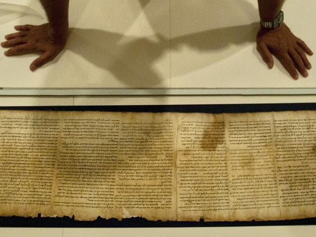 Part of the Isaiah Scroll, one of the Dead Sea Scrolls, inside the vault of the Shrine of the Book building at the Israel Museum in Jerusalem. Picture: AP