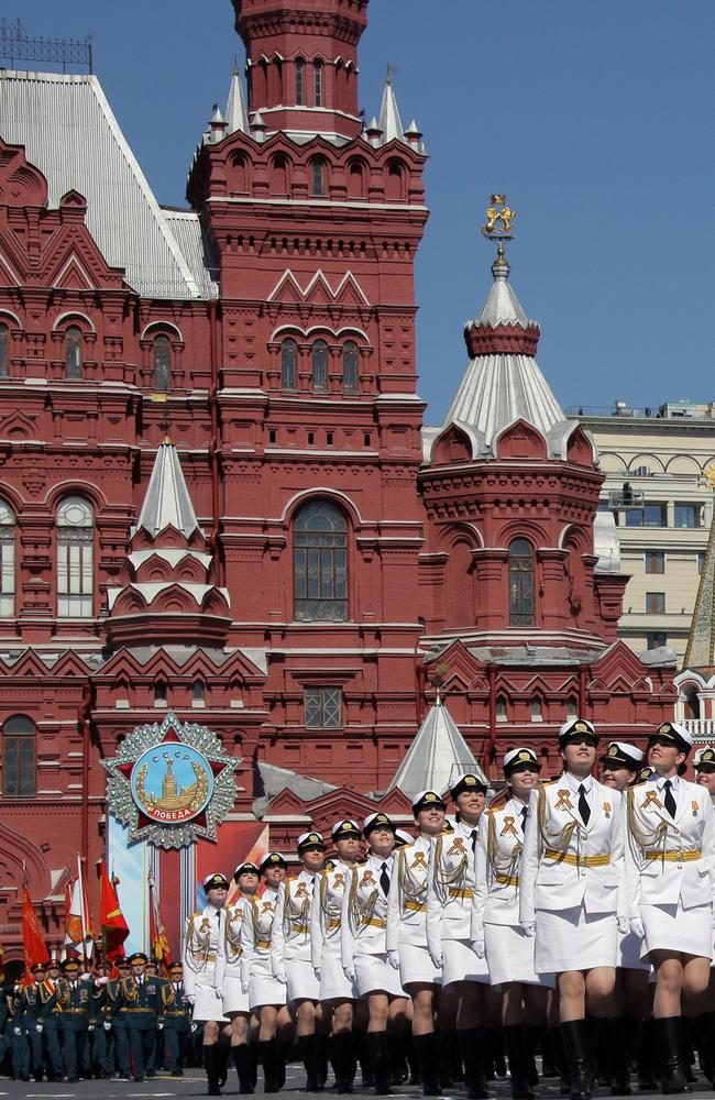 'Putin's miniskirt army' marches against the incredible backdrop of Moscow's Red Square. Picture: Mikhail Metzel\TASS via Getty Images