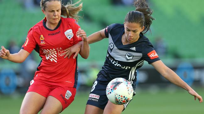 Angela Beard of Melbourne Victory fights for the ball with Adelaide's Georgia Campagnale. Picture: AAP