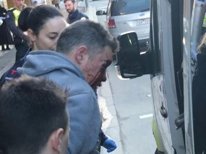 Jonathan Dick was taken to hospital in handcuffs. Picture: 7News Melbourne