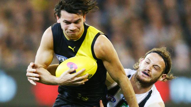 James Aish tackles Daniel Rioli in the preliminary final. Picture: Getty Images