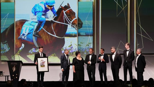 Team Winx, (from left) including part-owner Debbie Kepitis (third from left) and trainer Chris Waller (fifth from left) accept another award for Winx at the Sport Australia Hall of Fame 35th Induction and Awards Gala Dinner at the Palladium at Crown in Melbourne. Picture: AAP