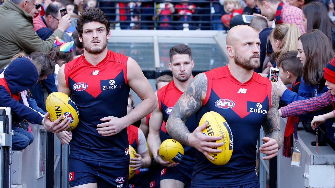 Angus Brayshaw and Nathan Jones lead the Demons out last weekend.