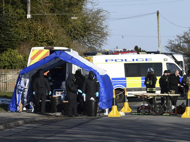 Various police, Army and other emergency service personal attend a scene in Durrington near Salisbury, England, as a car is taken away for further investigation into the suspected nerve agent attack. Picture: AP