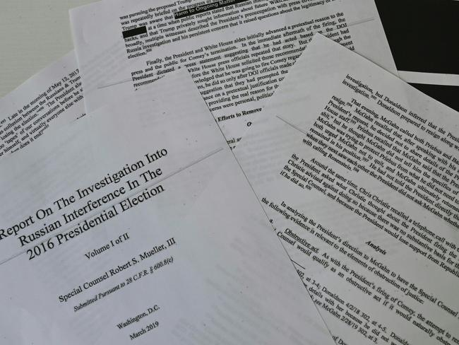An illustration shows printed pages of the Mueller Report. Picture: AFP