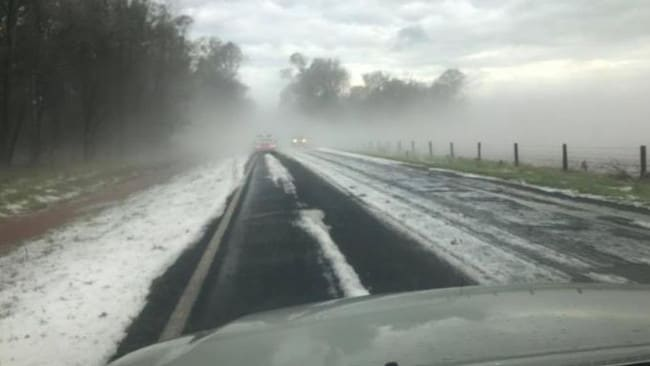 Kelly Randall shared this image on social media of hail the size of tennis balls blanketing the road near Tansey.
