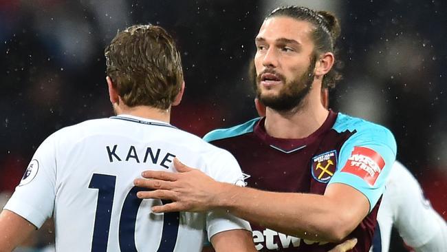 Tottenham Hotspur's English striker Harry Kane (L) greets West Ham United's English striker Andy Carroll (R)