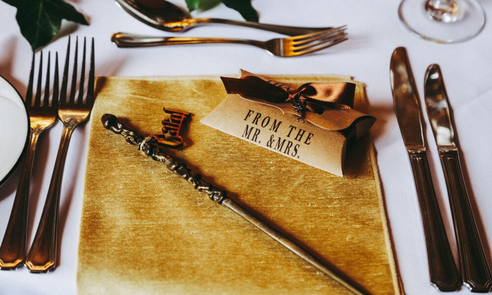 MERCURY PRESS. 29/10/18. Pictured: Placemats at the wedding came with each guests own wand. A Harry Potter superfan couple have tied the knot with a ?19,000 wedding themed on the film franchise. Newlyweds Caroline and Marcus Hewston, whisked their guests off to Scotland for a magical Harry Potter themed wedding. Three years after Marcus, 46, proposed, the loved up couple, from Walsall, West Midlands, finally married last week [October 20] at the stunning Dalhousie Castle in Bonnyrigg, Edinburgh. SEE MERCURY COPY. Photo Credit: Yorkshire Photo Studio/Mercury Press