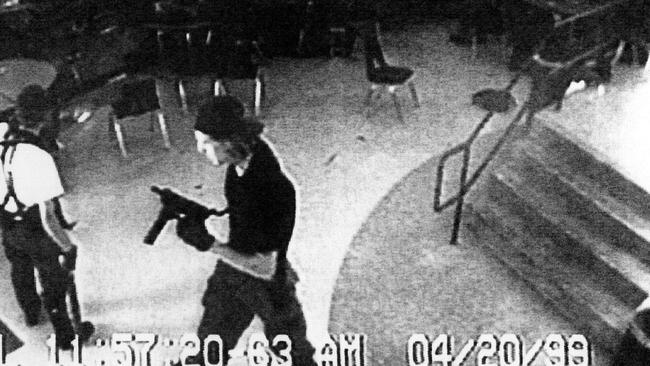 Eric Harris, left and Dylan Klebold, right, are shown on CCTV filmed inside a cafeteria during the Columbine shooting rampage. Picture: AP