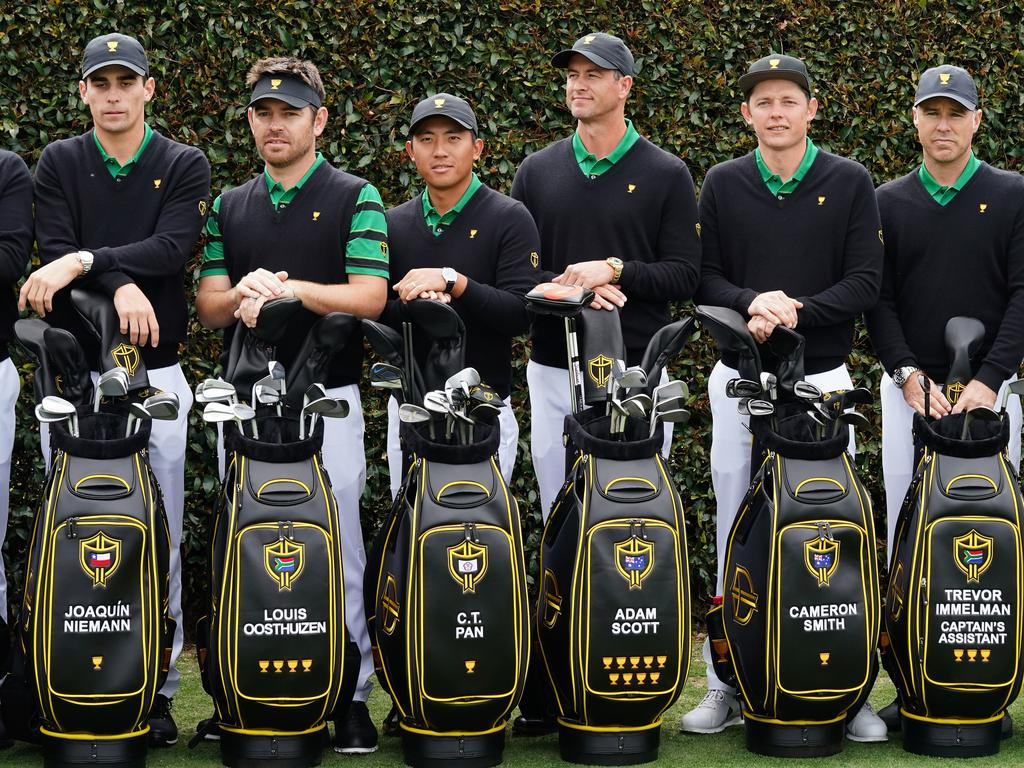 Joaquin Niemann of Chile, Louis Oosthuizen of South Africa, C.T. Pan of Taiwan, Adam Scott of Australia, Cameron Smith of Australia, Assistant Captain Trevor Immelman of South Africa and Assistant Captain Mike Weir of Canada pose for the International team photo ahead of the 2019 Presidents Cup golf competition at the Royal Melbourne Golf Club in Melbourne, Wednesday, December 11, 2019. (AAP Image/Scott Barbour) NO ARCHIVING, EDITORIAL USE ONLY
