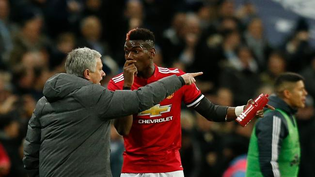 Manchester United's Portuguese manager Jose Mourinho (L) talks with Manchester Paul Pogba (R)