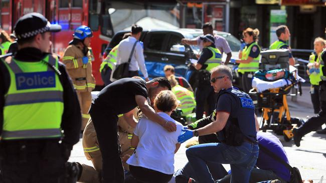 Police, fire and paramedics treat injured pedestrians. Picture: Aaron Francis/The Australian