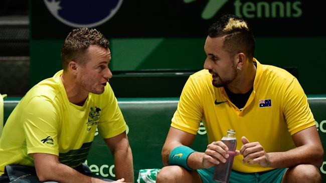 Australia's captain Lleyton Hewitt talks with Kyrgios. (Photo by JAVIER SORIANO / AFP)