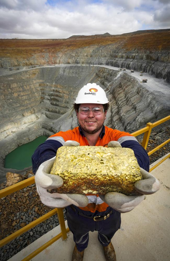 Apprentice fitter at Evolution Mining gold mine at Lake Cowal, near West Wyalong, NSW holds gold nugget.