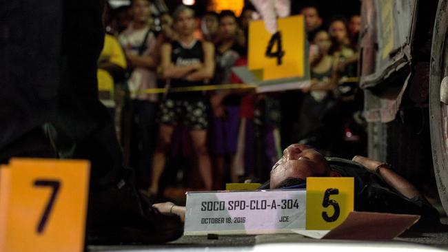 An alleged drug dealer was gunned down by unidentified men in Manila. Picture: APF / Noel Celis.