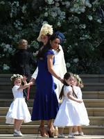 Britain's Catherine, Duchess of Cambridge (L) and Meghan Markle's friend, Canadian fashion stylist Jessica Mulroney (2L) hold bridesmaids hands as they arrive for the wedding ceremony of Britain's Prince Harry, Duke of Sussex and US actress Meghan Markle at St George's Chapel, Windsor Castle, in Windsor, on May 19, 2018. /Credit: AFP PHOTO / POOL / Jane Barlow