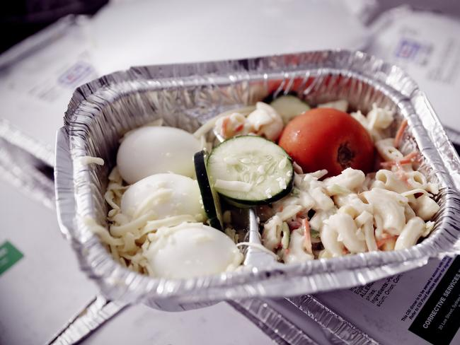 A prison dinner of pasta salad and eggs served in a metal tray may be waiting for prisoners after a long day at court. Picture: Sam Ruttyn