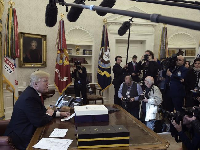Trump signed the Tax Cut and Reform Bill in the Oval Office. Picture: AFP